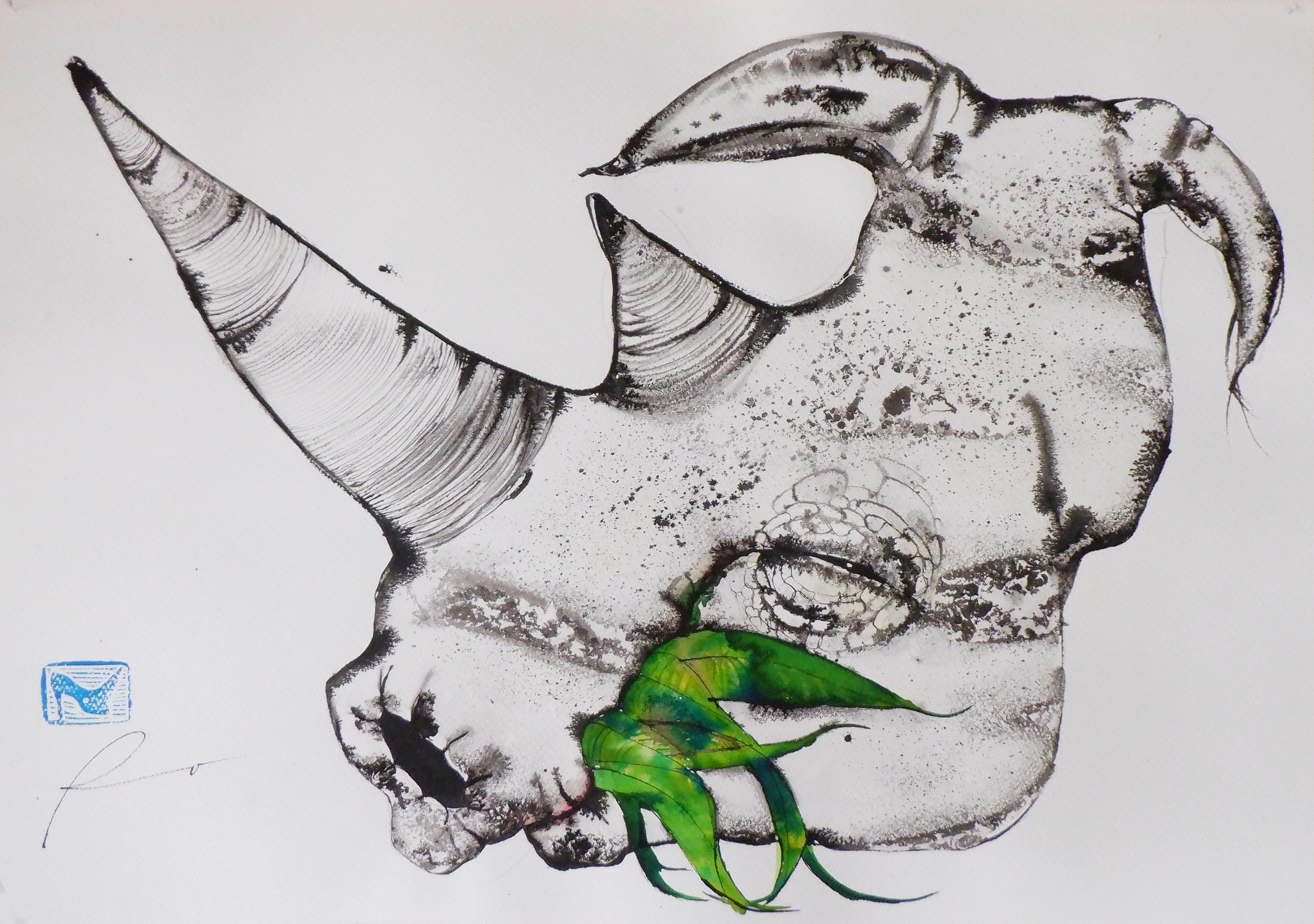 Cabeza de Rino comiendo hojas